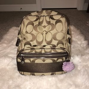 Coach backpack with purple flower